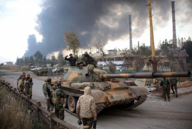 Ciidamada dowladda Suuriya oo dib ula wareegay degmada Aleppo. [Sawirka: AFP]